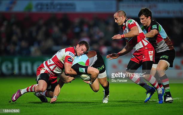 Harlequins fullback Mike Brown runs into a tackle from Henry Trinder during the Heineken Cup match between Gloucester and Harlequins at Kingsholm...