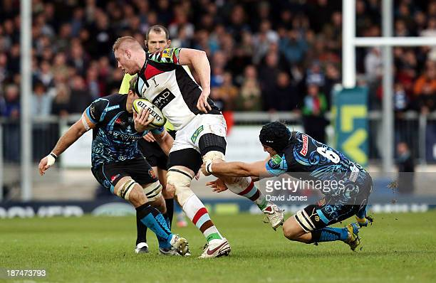 Harlequins' George Merrick is caught by Exeter Chiefs' Don Armand during the LV= Cup Round 1 match between Exeter Chiefs and Harlequins at Sandy Park...