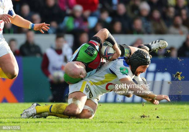 Harlequins George Robson challenges Clermont's Damien Chouly during the Heineken Cup Pool Four match at Twickenham Stoop London