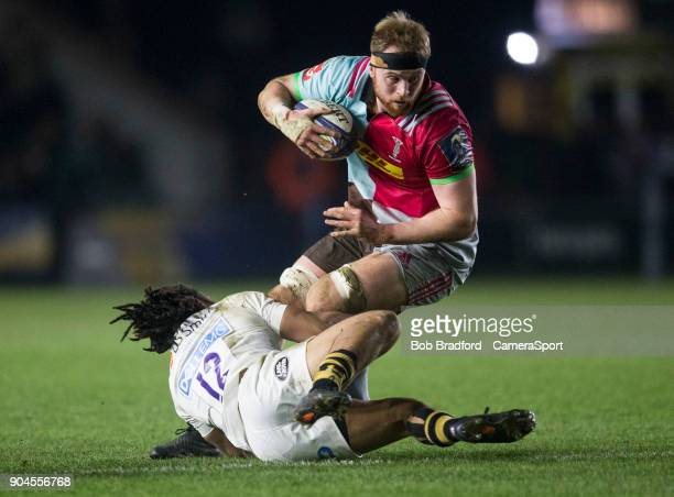 LONDON ENGLAND JANUARY Harlequins' James Chisholm is tackled by Wasps' Kyle Eastmond during the European Rugby Champions Cup match between Harlequins...