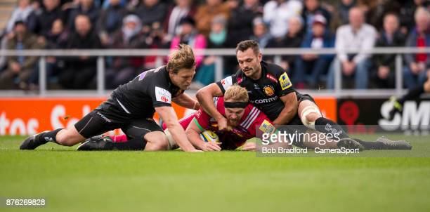 Harlequins' James Chisholm scores his sides first try during the Aviva Premiership match between Exeter Chiefs and Harlequins at Sandy Park on...