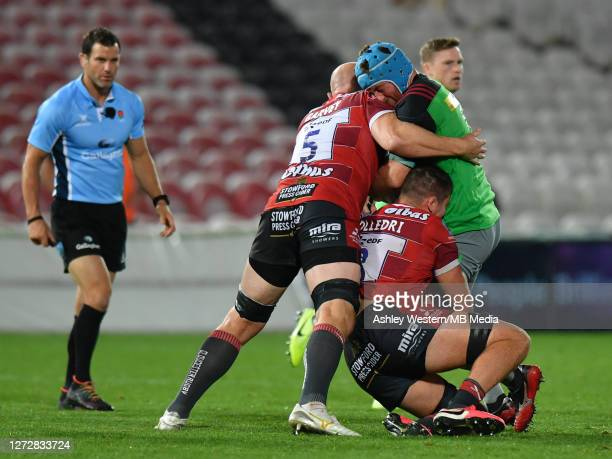 Harlequins' Joe Gray is tackled by Gloucester Rugby's Jack Stanley and Matt Garvey during the Gallagher Premiership Rugby match between Gloucester...