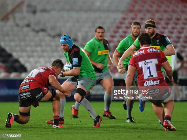 Harlequins' Joe Gray is tackled by Gloucester Rugby's Jack Stanley during the Gallagher Premiership Rugby match between Gloucester Rugby and...