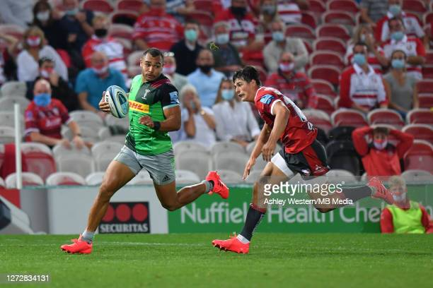 Harlequins' Joe Marchant evades the tackle of Gloucester Rugby's Louis ReesZammit during the Gallagher Premiership Rugby match between Gloucester...