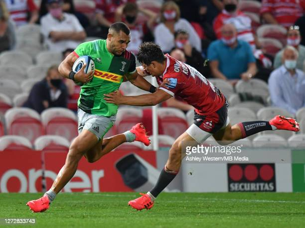Harlequins' Joe Marchant is tackled by Gloucester Rugby's Louis ReesZammit during the Gallagher Premiership Rugby match between Gloucester Rugby and...