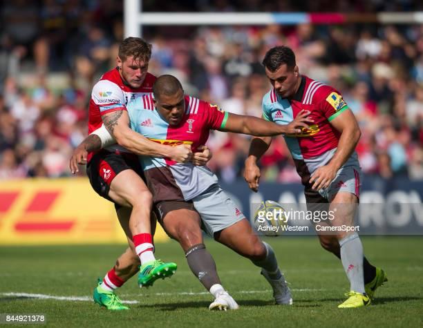 Harlequins' Kyle Sinckler battles for possession with Gloucester Rugby's Jason Woodward during the Aviva Premiership match between Harlequins and...