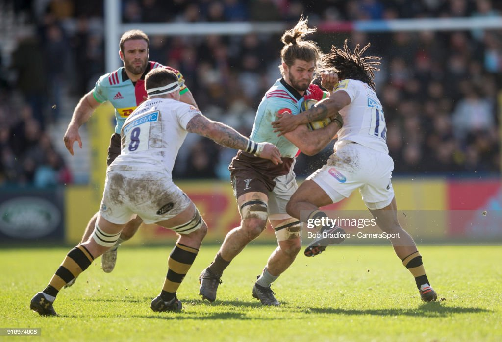 Harlequins' Luke Wallace is tackled by Wasps' Kyle Eastmond during the Aviva Premiership match between Harlequins and Wasps at Twickenham Stoop on February 11, 2018 in London, England.
