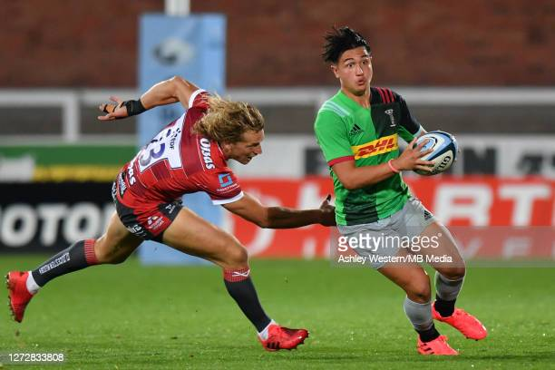 Harlequins' Marcus Smith evades the tackle of Gloucester Rugby's Billy Twelvetrees during the Gallagher Premiership Rugby match between Gloucester...