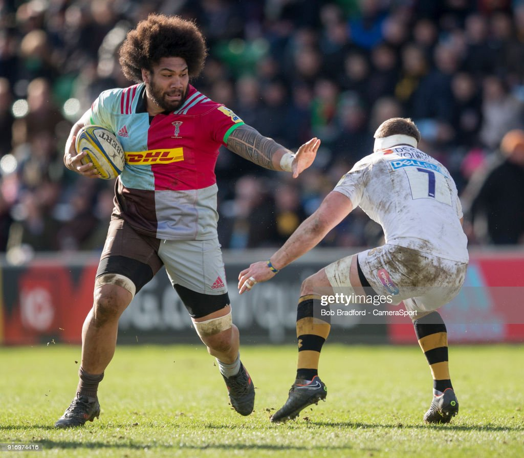 Harlequins' Mathew Luamanu evades the tackle of Wasps' Thomas Young during the Aviva Premiership match between Harlequins and Wasps at Twickenham Stoop on February 11, 2018 in London, England.