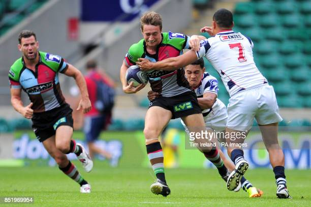 Harlequins' Miles Mantella is tackled in the semi final against Auckland during the World Club Sevens at Twickenham Stadium London