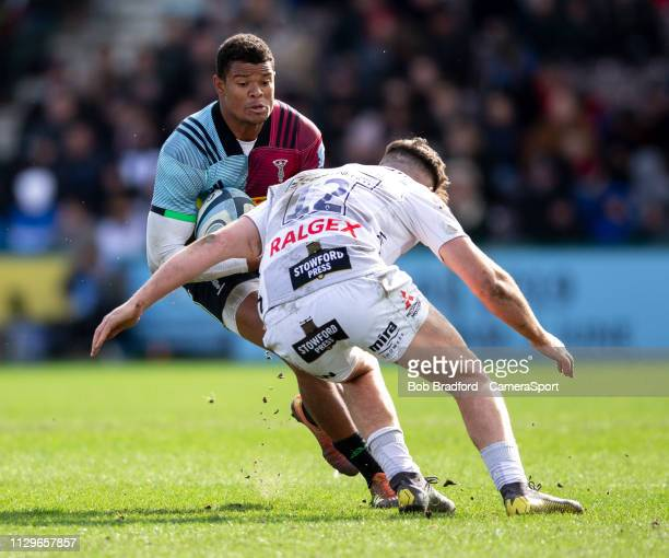 Harlequins' Nathan Earle is tackled by Gloucester's Mark Atkinson during the Gallagher Premiership Rugby match between Harlequins and Gloucester...
