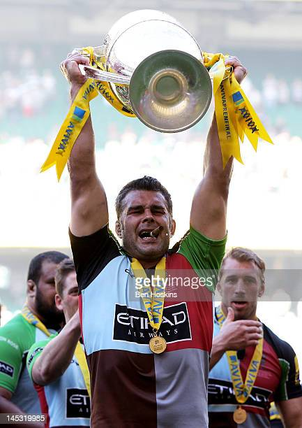Harlequins number 8 Nick Easter celebrates with the trophy following his team's victory during the Aviva Premiership final between Harlequins and...