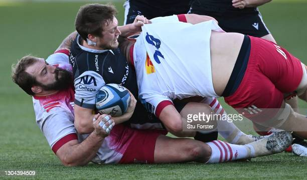 Harlequins players Joe Marler and Alex Dombrandt tackle Falcons player Brett Connon during the Gallagher Premiership Rugby match between Newcastle...