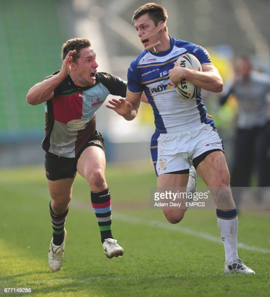 Harlequins RL's Luke Dorn chases after Hull FC's Tom Briscoe