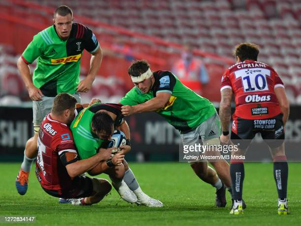 Harlequins' Scott Baldwin is tackled by Gloucester Rugby's Ed Slater as Harlequins' Will Evans looks on during the Gallagher Premiership Rugby match...