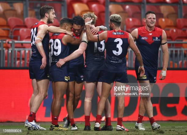 Harley Bennell of the Demons celebrates a goal after the final siren during the round 6 AFL match between the Melbourne Demons and the Gold Coast...