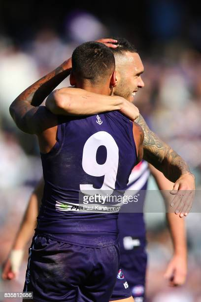Harley Bennell of the Dockers celebrates a goal with Bradley Hill during the round 22 AFL match between the Fremantle Dockers and the Richmond Tigers...