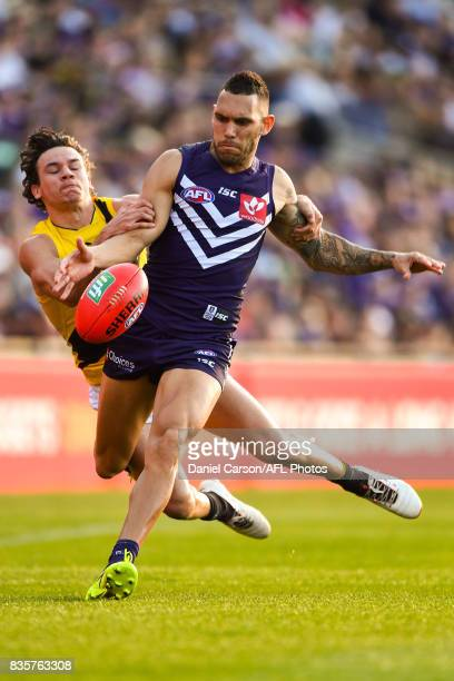 Harley Bennell of the Dockers is tackled by Daniel Rioli of the Tigers during the 2017 AFL round 22 match between the Fremantle Dockers and the...