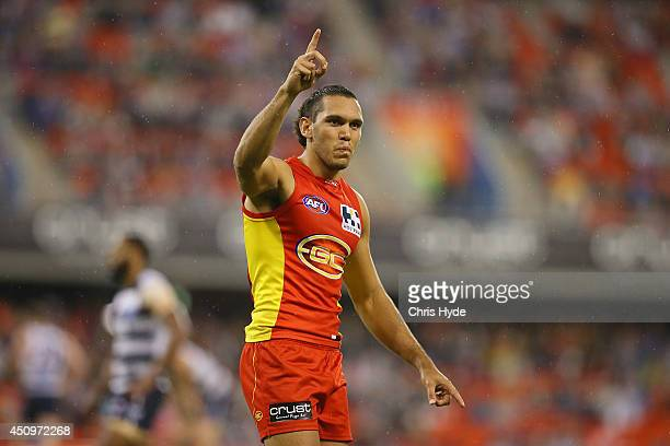 Harley Bennell of the Suns celebrates a goal during the round 14 AFL match between the Gold Coast Suns and the Geelong Cats at Metricon Stadium on...