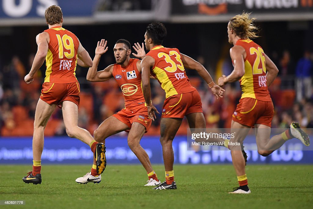 Harley Bennell of the Suns celebrates with goal scorer Tom Lynch during the round 18 AFL match between the Gold Coast Suns and the West Coast Eagles at Metricon Stadium on August 1, 2015 in Gold Coast, Australia.
