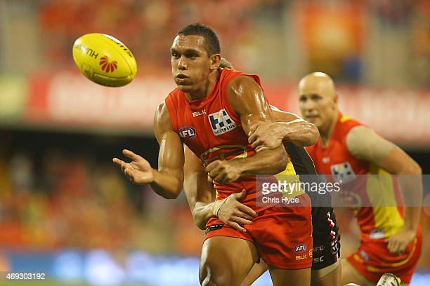 Harley Bennell of the Suns handballs during the round two AFL match between the Gold Coast Suns and the St Kilda Saints at Metricon Stadium on April...