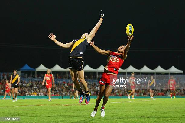 Harley Bennell of the Suns marks behind Brett Deledio of the Tigers during the round 16 AFL match between the Richmond Tigers and the Gold Coast Suns...