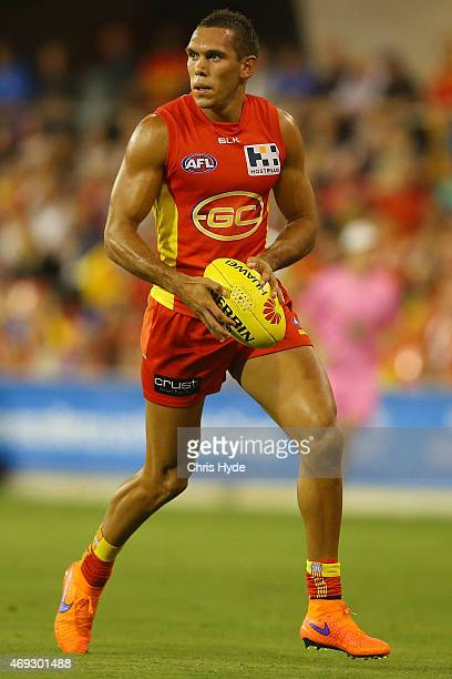 Harley Bennell of the Suns runs the ball during the round two AFL match between the Gold Coast Suns and the St Kilda Saints at Metricon Stadium on...