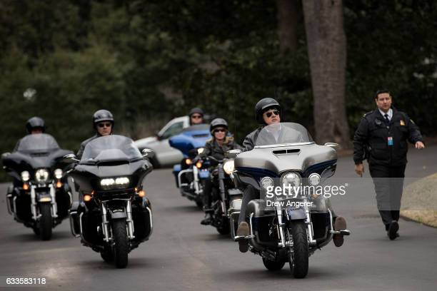 Harley Davidson executives ride their motorcycles as they arrive on the South Lawn of the White House February 2 2017 in Washington DC President...