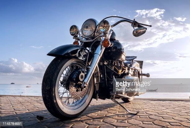 harley davidson motorbike on ao nang sea promenade - bernd schunack stock pictures, royalty-free photos & images