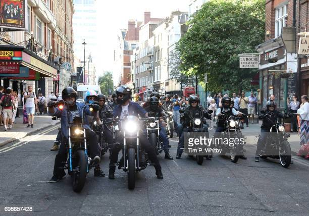 Harley Davidson motorbikes are driven down St Martins Lane as part of the celebration of the press night of 'Bat Our Of Hell The Musical' at The...