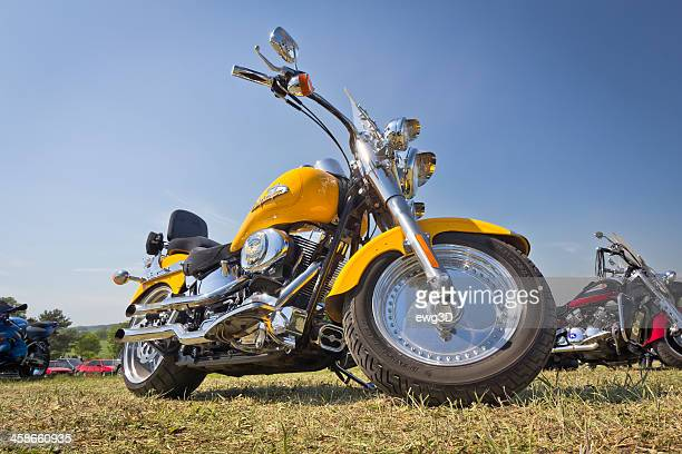 harley davidson motorcycle against blue sky - brand name stock pictures, royalty-free photos & images