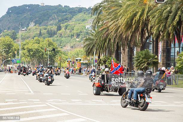 Harley Davidson riders on the Barcelona city street parade with United States south flag
