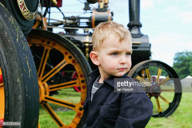 Harley James from Middleton in Teesdale helps to clean a steam engine during the Duncombe Park Steam Rally on July 1 2017 in Helmsley United Kingdom...
