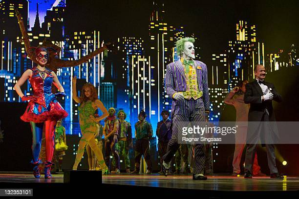 Harley Quinn played by actress Poppy Tierney Poison Ivy played by actress Valerie Murzak and The Joker played by actor Mark Frost of Batman Live...