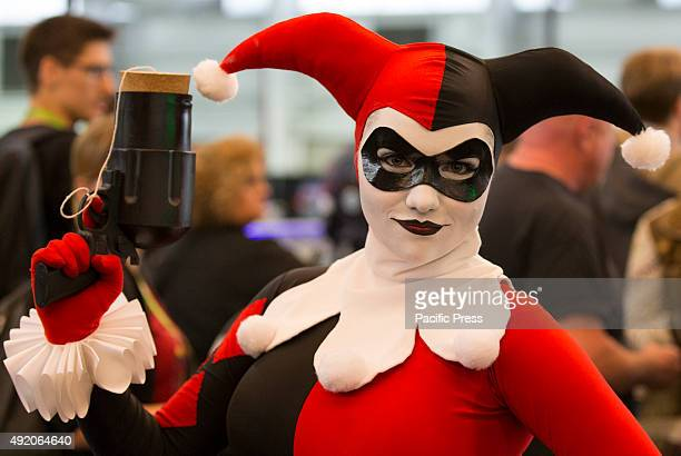 Harley Quinn poses in costume during the first day of New York Comic Con at The Jacob K Javits Convention Center in New York City