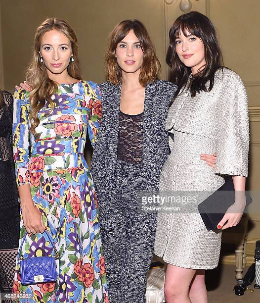 Harley Viera-Newton, Alexa Chung and Dakota Johnson attend the CHANEL Paris-Salzburg 2014/15 Metiers d'Art Collection in New York City at the Park...