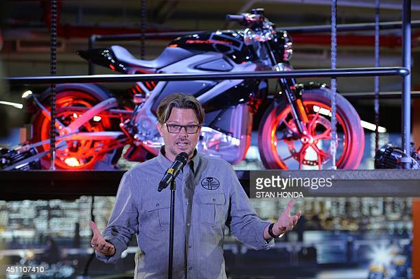 HarleyDavidson chief marketing officer MarkHans Richer speaks in front of a Project LiveWire motorcycle the company's first electric motorcycle...