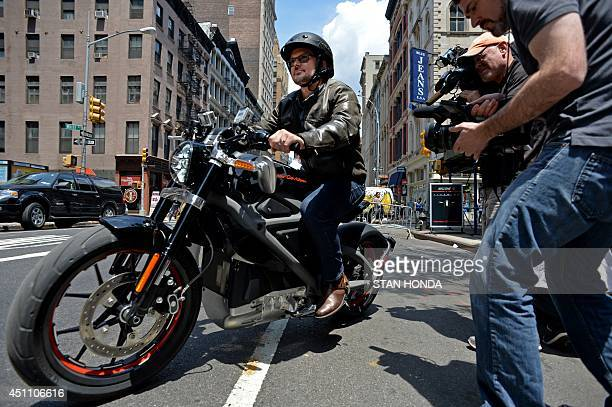 HarleyDavidson chief marketing officer MarkHans Richer takes a Project LiveWire the company's first electric motorcycle for a ride during a preview...