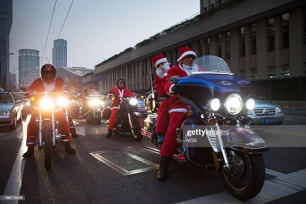 Harley-Davidson drivers dressed as Santa Claus parade to celebrate Christmas on December 24, 2012 in Shanghai, China.