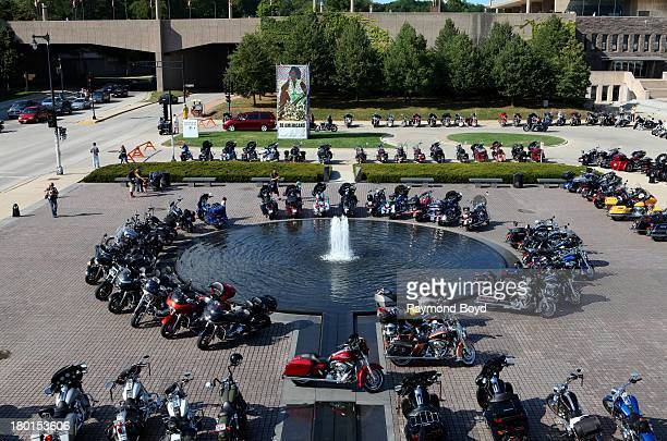 HarleyDavidson motorcycles from around the world sits at the fountain outside the Milwaukee Art Museum to commemorate the HarleyDavidson 110th Year...