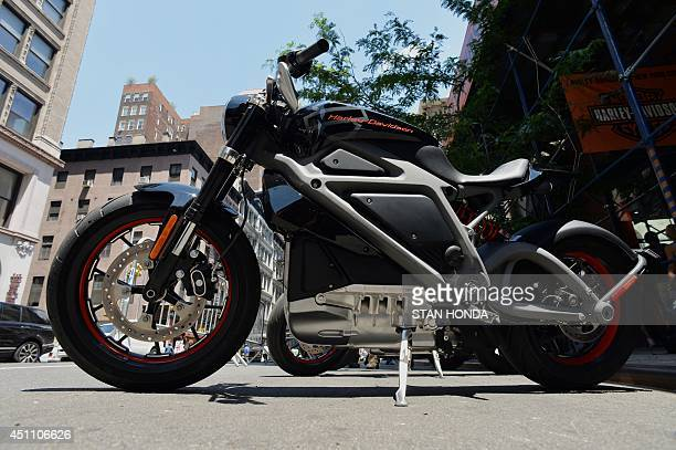 A HarleyDavidson Project LiveWire the company's first electric motorcycle during a preview June 23 2014 outside a HarleyDavidson dealer in New York...