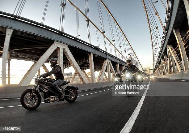HarleyDavidson riders reveal Project LiveWire the first electric HarleyDavidson motorcycle during a special ride across the iconic Manhattan Bridge...