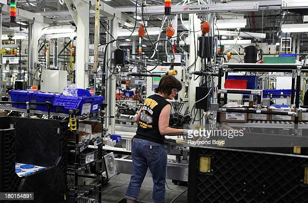 HarleyDavidson worker works on the FL Rotor assembly at the HarleyDavidson Pilgrim Road Powertrain Operations Plant in Menomonee Falls Wisconsin on...
