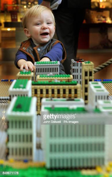 Harli Cook aged 15 months from Ashford in Kent plays with a LEGO model of the Olympic Athletes Village in the Westfield shopping centre in Stratford...