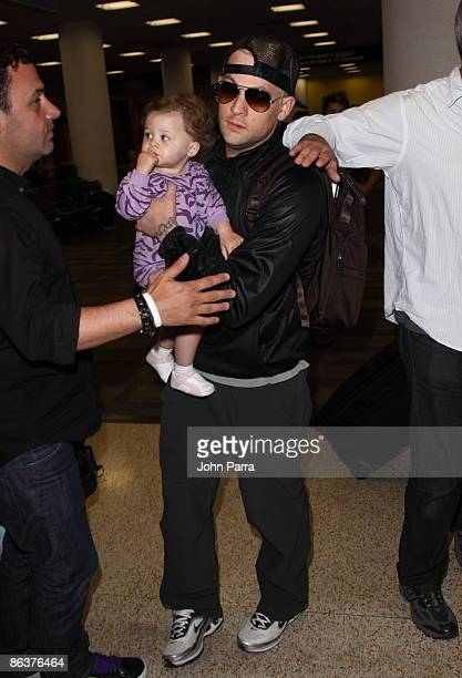 Harlow Winter Kate Madden and father Joel Madden are seen at Miami International Airport on May 4 2009 in Miami Beach Florida