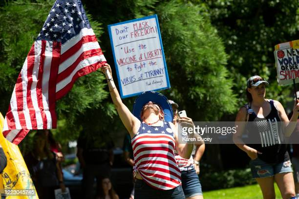 Harlyn Thompson from Battleground, Washington joins others at a Patriot Prayer and Peoples Rights Washington rally protesting the Washington state...