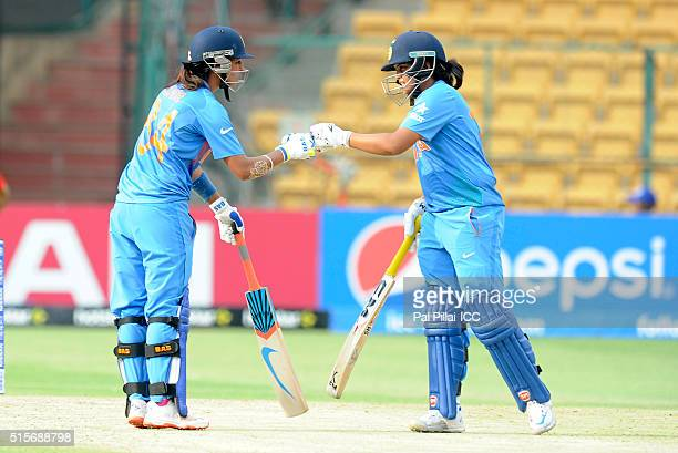 Harmanpreet Kaur of India and Veda Krishnamurthy of India punch gloves during the Women's ICC World Twenty20 India 2016 match between India and...