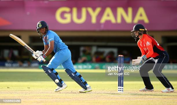 Harmanpreet Kaur of India bats with Amy Jones wicket keeper of England looking on during the warm up match between England and India ahead of the ICC...