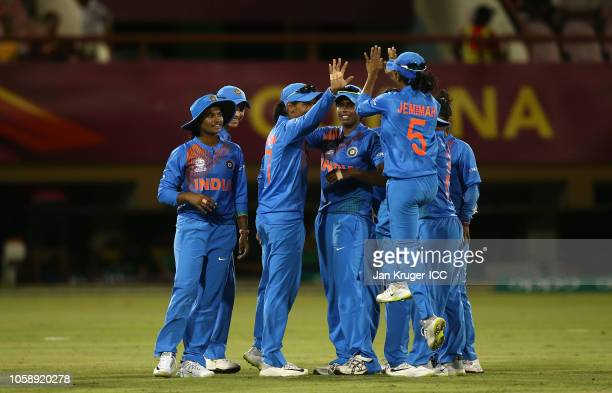 Harmanpreet Kaur of India celebrates a wicket with team mates during the warm up match between England and India ahead of the ICC Women's World T20...