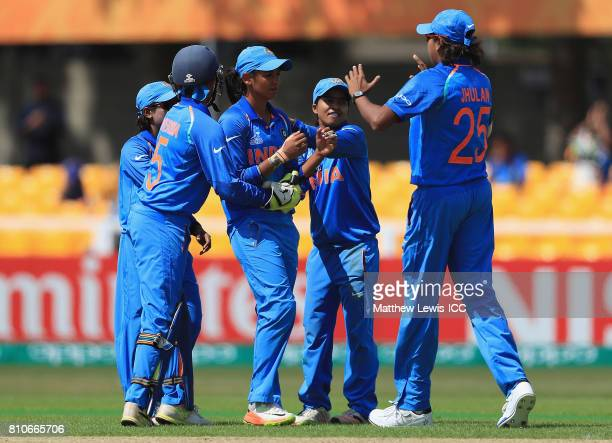 Harmanpreet Kaur of India is congratulated on bowling Lizelle Lee of South Africa for LBW during the ICC Women's World Cup 2017 match between South...